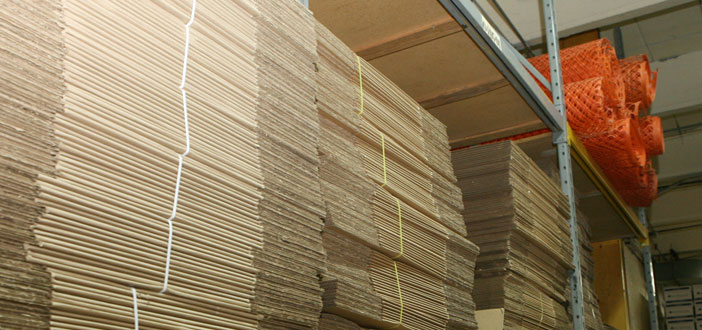 Stacks of folded moving boxes in warehouse