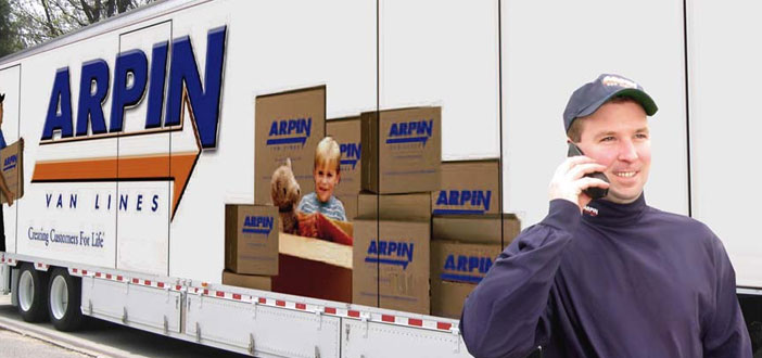Employee on phone in front of Arpin truck